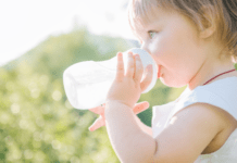 getting your baby to stop using a bottle: toddler drinking out of a bottle