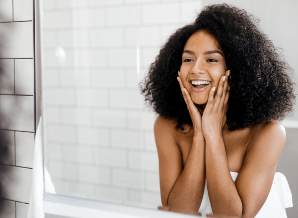 Everything you need to know about your skin during pregnancy and breastfeeding: woman looking at a mirror