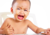 how to deal with toddler tantrums: boy toddler throwing a tantrum