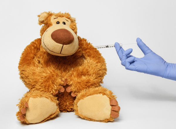 what should you do if your child has missed a vaccination on the south african schedule: teddy bear getting vaccinated