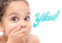 halitosis and bad breath in children: little girl covering her mouth