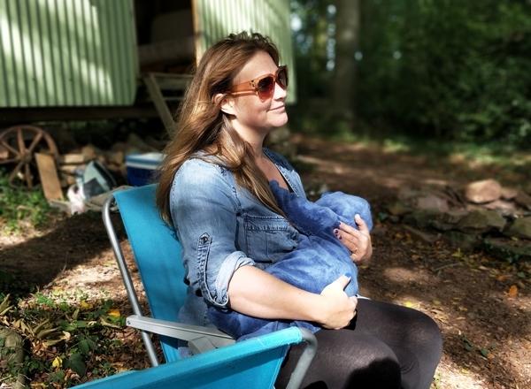 breastfeeding and cbd: mom feeding baby outdoors happy