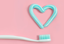 how to choose the right toothbrush and toothpaste for your child: toothbrush with heart drawn in toothpaste