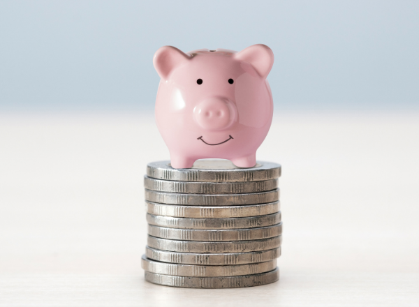 piggy bank on a stack of coins: midlife money makeover