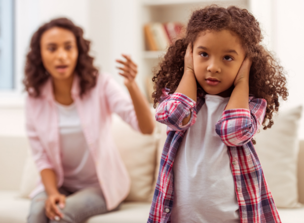 mother criticising a child girl covers her ears: why criticism is good for your child