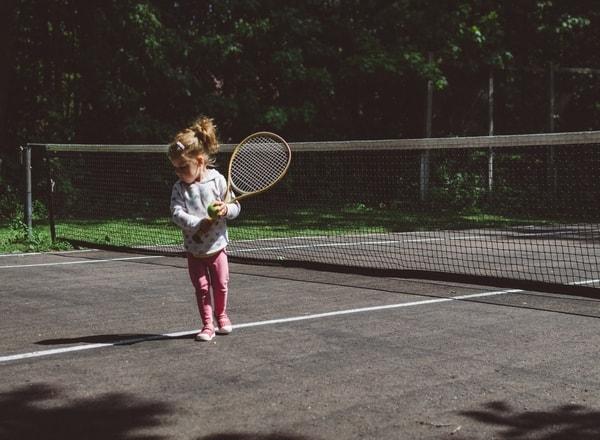 child at tennis court