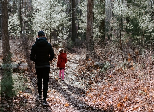 father and daughter walking a trail together