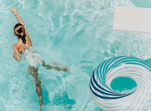 girl swimming at holiday resort