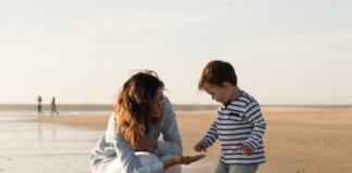 mother and son at the beach: post baby body