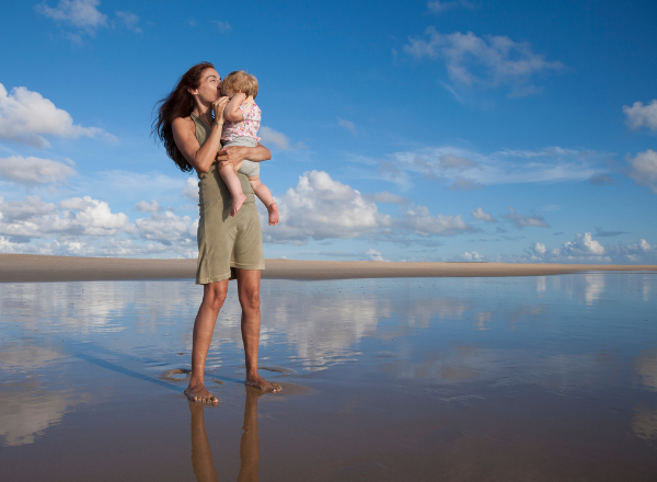 woman and child on beach: someone asked me if having a baby made me not want to wear a bikini and this is what i wish i had said
