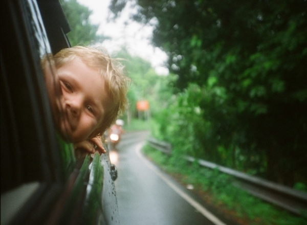 road trip with toddlers south africa: toddler car window head nature