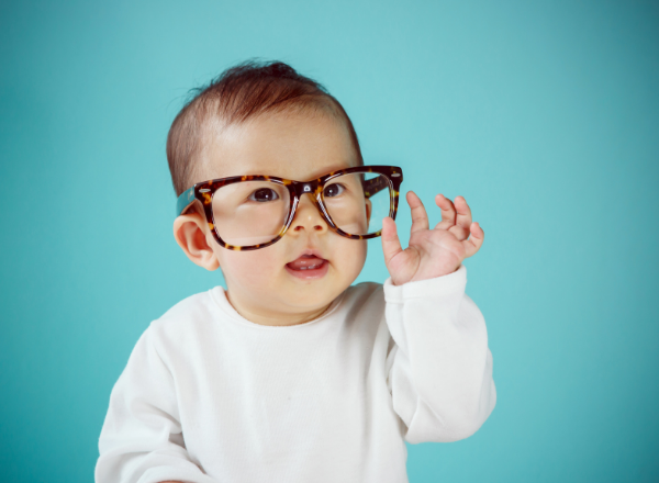 baby wearing glasses: why you should have your child's eyes tested in their first year of life