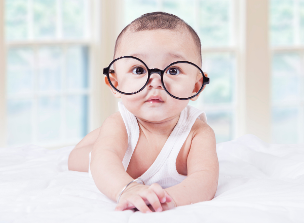 baby wearing glasses: why you should have your child's eyes tested in the first year of their life
