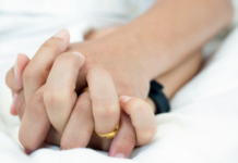 a couple holding hands in bed: surprising things a sexologist wants you to know about sexual desire