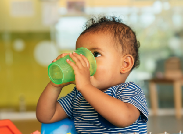 baby drinking water from a cup: when can I give my baby water to drink